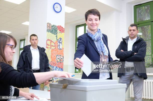 Frauke Petry coleader of Germany's rightwing populist AfD party casts her vote at a polling station in Leipzig eastern Germany during general...