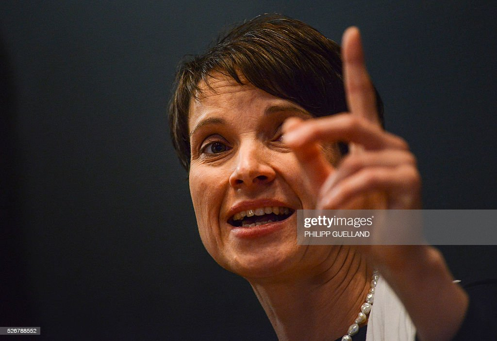 Frauke Petry gestures during a party congress of the German right wing party AfD (Alternative fuer Deutschland) at the Stuttgart Congress Centre ICS on May 1, 2016 in Stuttgart, southern Germany. / AFP / Philipp GUELLAND