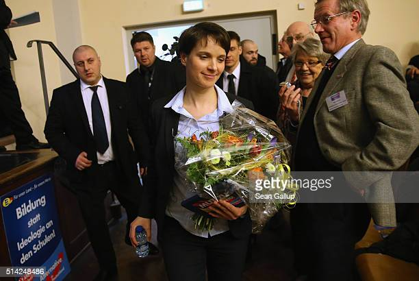 Frauke Petry head of the AfD political party holds flowers she received after she spoke to supporters at an AfD BadenWuerttemberg state election...