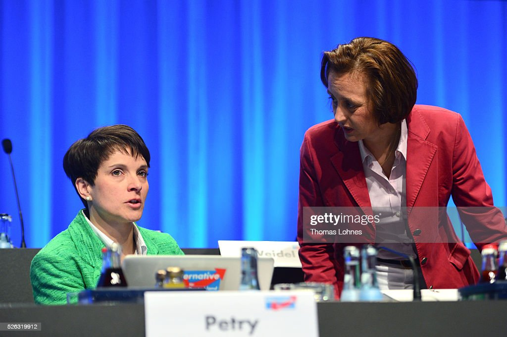 Frauke Petry (L), head of the Alternative fuer Deutschland (AfD) political party, and AfD co-deputy head Beatrix von Storch (R) speak together at the party's federal congress on April 30, 2016 in Stuttgart, Germany. The AfD, a relative newcomer to the German political landscape, has emerged from Euro-sceptic conservatism towards a more right-wing leaning appeal based in large part on opposition to Germany's generous refugees and migrants policy. Since winning seats in March elections in three German state parliaments the party has sharpened its tone, calling for a ban on minarets and claiming that Islam does not belong in Germany.