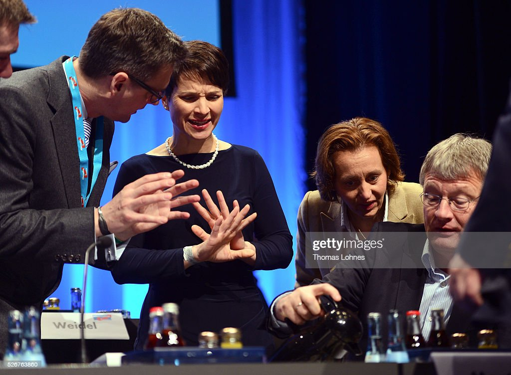 Frauke Petry (2-L), head of the Alternative fuer Deutschland (AfD) political party, AfD co-deputy head Beatrix von Storch (2-R) and AfD co-leader Joerg Meuthen (R) diskuss before the beginning of the second day of the party's federal congress on May 01, 2016 in Stuttgart, Germany. A server of the party had been hacked by a left political group and the addresses of AfD members has been published. The AfD, a relative newcomer to the German political landscape, has emerged from Euro-sceptic conservatism towards a more right-wing leaning appeal based in large part on opposition to Germany's generous refugees and migrants policy. Since winning seats in March elections in three German state parliaments the party has sharpened its tone, calling for a ban on minarets and claiming that Islam does not belong in Germany.