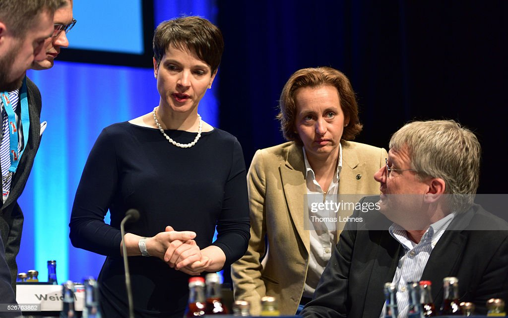 Frauke Petry (L), head of the Alternative fuer Deutschland (AfD) political party, AfD co-deputy head Beatrix von Storch (2-R) and AfD co-leader Joerg Meuthen (R) diskuss before the beginning of the second day of the party's federal congress on May 01, 2016 in Stuttgart, Germany. A server of the party had been hacked by a left political group and the addresses of AfD members has been published. The AfD, a relative newcomer to the German political landscape, has emerged from Euro-sceptic conservatism towards a more right-wing leaning appeal based in large part on opposition to Germany's generous refugees and migrants policy. Since winning seats in March elections in three German state parliaments the party has sharpened its tone, calling for a ban on minarets and claiming that Islam does not belong in Germany.