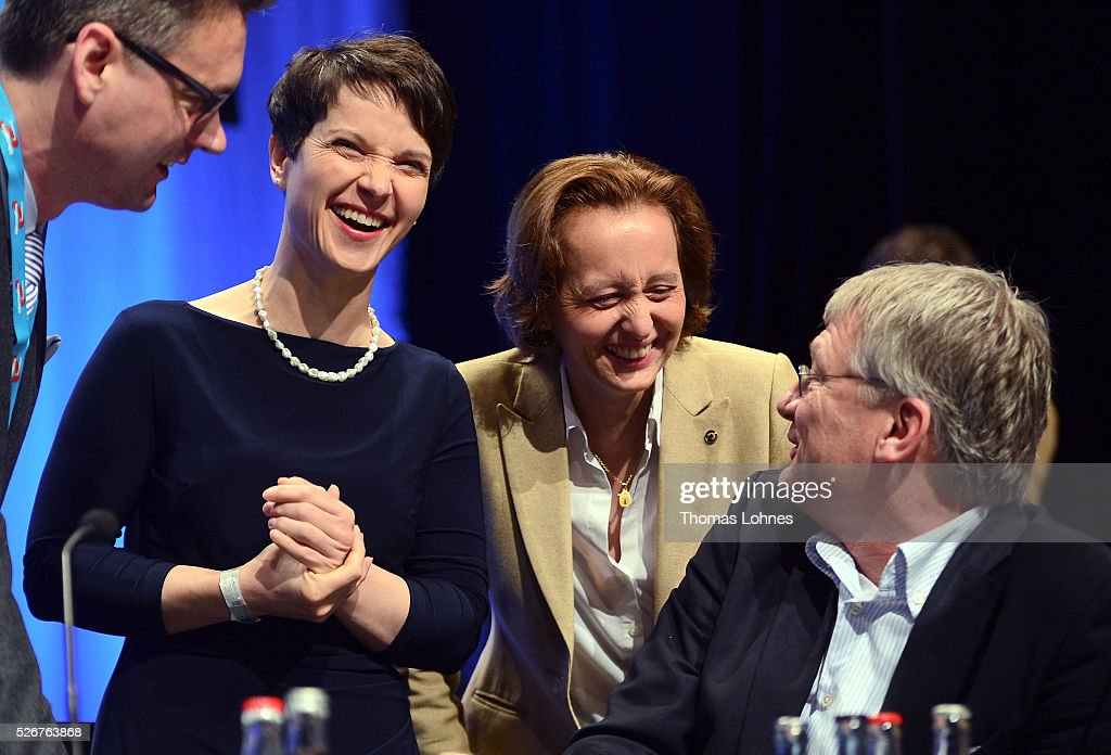 Frauke Petry (2-L), head of the Alternative fuer Deutschland (AfD) political party, AfD co-deputy head Beatrix von Storch (2-R) and AfD co-leader Joerg Meuthen (R) diskuss before the beginning of the second day of the party's federal congress on May 01, 2016 in Stuttgart, Germany. The AfD, a relative newcomer to the German political landscape, has emerged from Euro-sceptic conservatism towards a more right-wing leaning appeal based in large part on opposition to Germany's generous refugees and migrants policy. Since winning seats in March elections in three German state parliaments the party has sharpened its tone, calling for a ban on minarets and claiming that Islam does not belong in Germany.