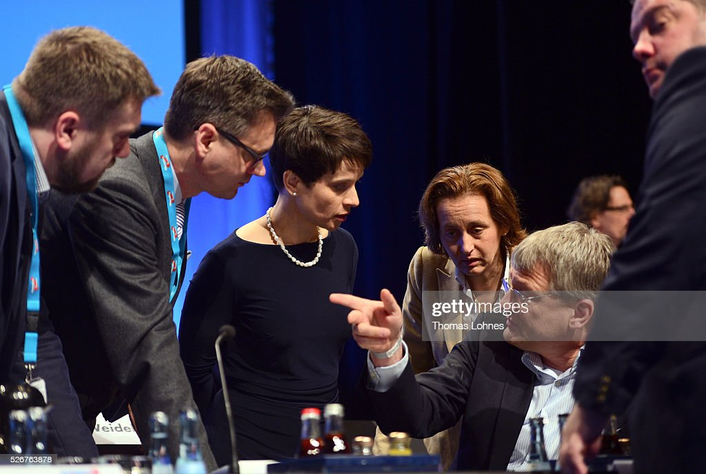 Frauke Petry (3-L), head of the Alternative fuer Deutschland (AfD) political party, AfD co-deputy head Beatrix von Storch (4-R) and AfD co-leader Joerg Meuthen (3-R) diskuss before the beginning of the second day of the party's federal congress on May 01, 2016 in Stuttgart, Germany. A server of the party had been hacked by a left political group and the addresses of AfD members has been published. The AfD, a relative newcomer to the German political landscape, has emerged from Euro-sceptic conservatism towards a more right-wing leaning appeal based in large part on opposition to Germany's generous refugees and migrants policy. Since winning seats in March elections in three German state parliaments the party has sharpened its tone, calling for a ban on minarets and claiming that Islam does not belong in Germany.