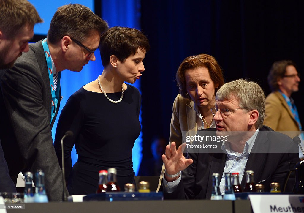 Frauke Petry (3-L), head of the Alternative fuer Deutschland (AfD) political party, AfD co-deputy head Beatrix von Storch (2-R) and AfD co-leader Joerg Meuthen (R) diskuss before the beginning of the second day of the party's federal congress on May 01, 2016 in Stuttgart, Germany. A server of the party had been hacked by a left political group and the addresses of AfD members has been published. The AfD, a relative newcomer to the German political landscape, has emerged from Euro-sceptic conservatism towards a more right-wing leaning appeal based in large part on opposition to Germany's generous refugees and migrants policy. Since winning seats in March elections in three German state parliaments the party has sharpened its tone, calling for a ban on minarets and claiming that Islam does not belong in Germany.