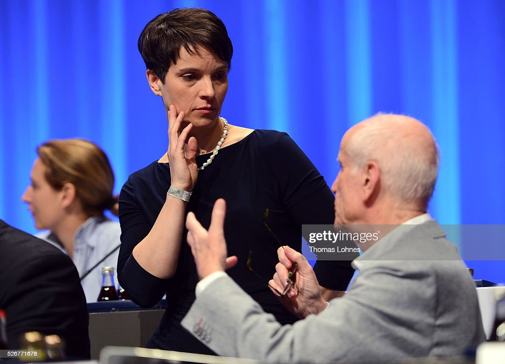Frauke Petry (C), head of the Alternative fuer Deutschland (AfD) political party and Albrecht Glaser (R) pictured at the party's federal congress on May 01, 2016 in Stuttgart, Germany. A server of the party had been hacked by a left political group and the addresses of AfD members has been published. The AfD, a relative newcomer to the German political landscape, has emerged from Euro-sceptic conservatism towards a more right-wing leaning appeal based in large part on opposition to Germany's generous refugees and migrants policy. Since winning seats in March elections in three German state parliaments the party has sharpened its tone, calling for a ban on minarets and claiming that Islam does not belong in Germany.
