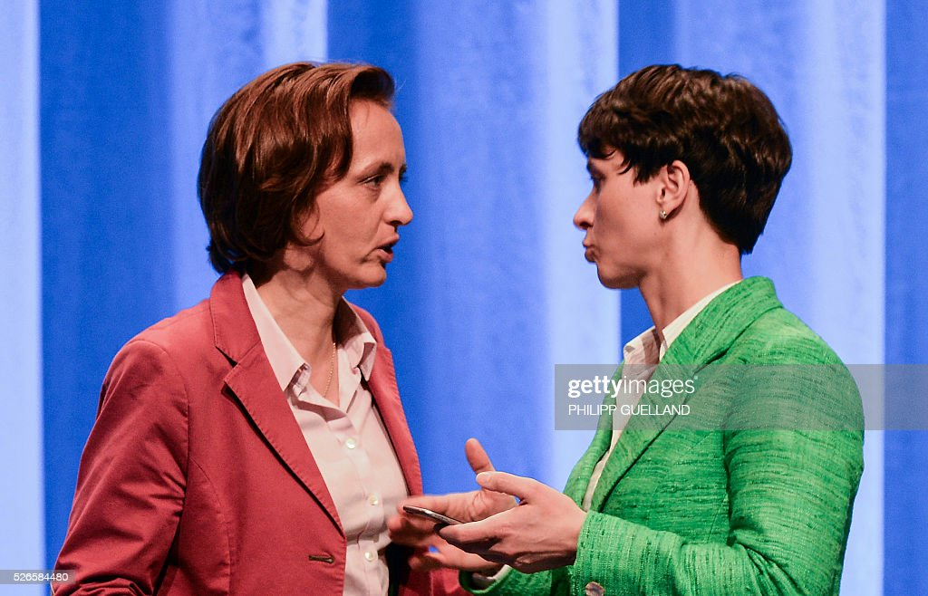 Frauke Petry (R),leader of the german right wing party Alternative for Germany (AfD) speaks with her deputy Beatrix von Storch, during the party congress at the Stuttgart Congress Centre ICS on April 30, 2016. The Alternative for Germany (AfD) party is meeting in the western city of Stuttgart, where it is expected to adopt an anti-Islamic manifesto, emboldened by the rise of European anti-migrant groups like Austria's Freedom Party. / AFP / Philipp GUELLAND