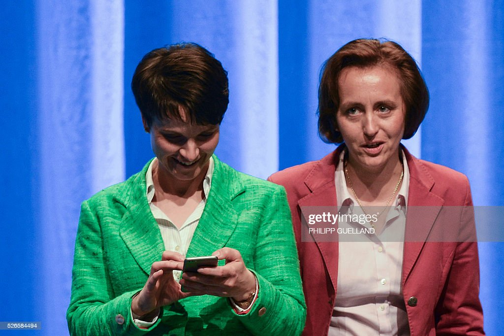 Frauke Petry (L),leader of the german right wing party Alternative for Germany (AfD) and her deputy Beatrix von Storch, attend the party congress at the Stuttgart Congress Centre ICS on April 30, 2016. The Alternative for Germany (AfD) party is meeting in the western city of Stuttgart, where it is expected to adopt an anti-Islamic manifesto, emboldened by the rise of European anti-migrant groups like Austria's Freedom Party. / AFP / Philipp GUELLAND