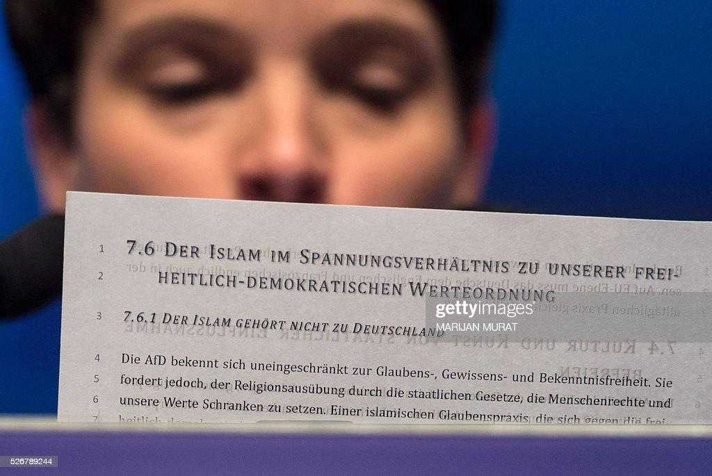 Frauke Petry, leader of the german right wing party Alternative for Germany (AfD) holds a paper reading ' The Islam does not belong to Germany' during a party congress of the German right wing party AfD (Alternative fuer Deutschland) at the Stuttgart Congress Centre ICS on May 1, 2016 in Stuttgart, southern Germany. / AFP / dpa / Marijan Murat / Germany OUT
