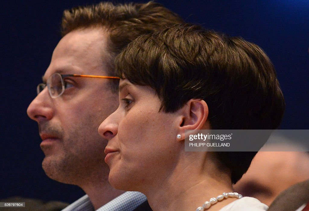 Frauke Petry (R),leader of the German right wing party Alternative for Germany (AfD) and her partner AFD's leader in North Rhine-Westphalia, Marcus Pretzell attend a party congress of the German right wing party AfD (Alternative fuer Deutschland) at the Stuttgart Congress Centre ICS on May 1, 2016 in Stuttgart, southern Germany. / AFP / Philipp GUELLAND