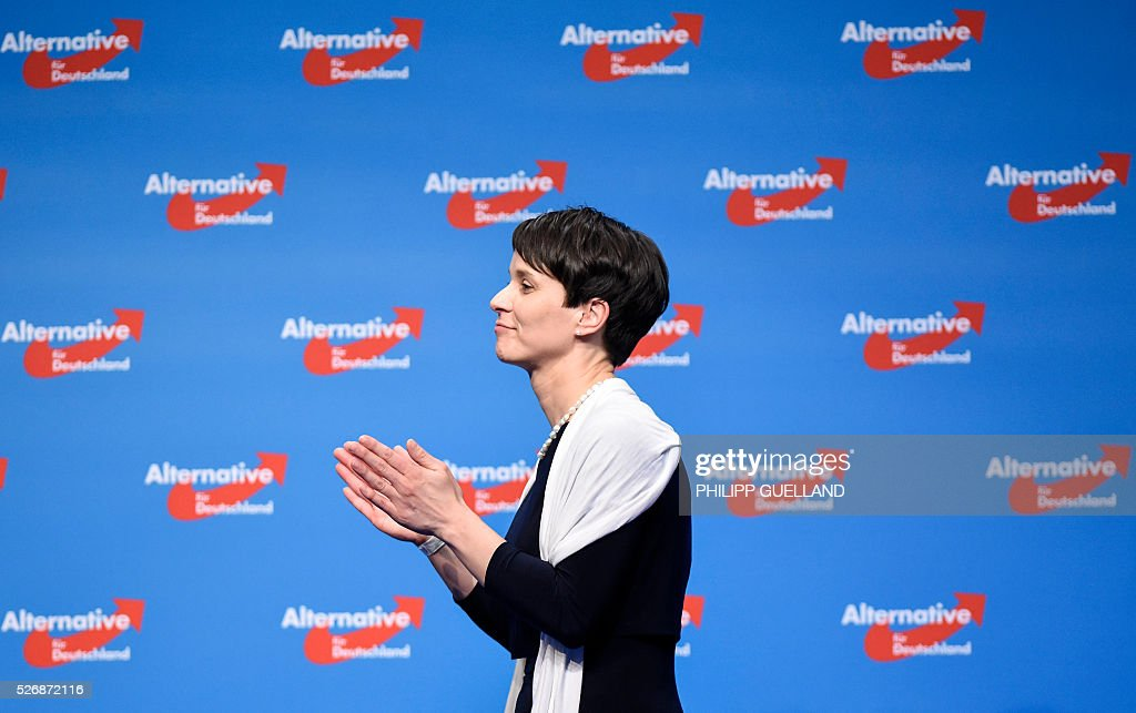 Frauke Petry, leader of the german right wing party Alternative for Germany (AfD) applauds at the end of their party congress at the Stuttgart Congress Centre ICS on May 1, 2016 in Stuttgart, southern Germany. Germany's right-wing populist AfD adopted an anti-Islam policy in a manifesto that also demands curbs to immigration, as a poll showed it is now the country's third strongest party. / AFP / Philipp GUELLAND