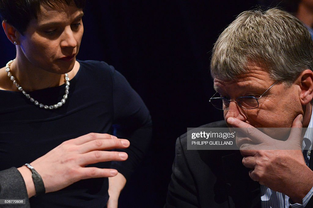 Frauke Petry,leader of the german right wing party Alternative for Germany (AfD) and her deputy Joerg Meuthen talk during a party congress of the German right wing party AfD (Alternative fuer Deutschland) at the Stuttgart Congress Centre ICS on May 1, 2016 in Stuttgart, southern Germany. / AFP / Philipp GUELLAND