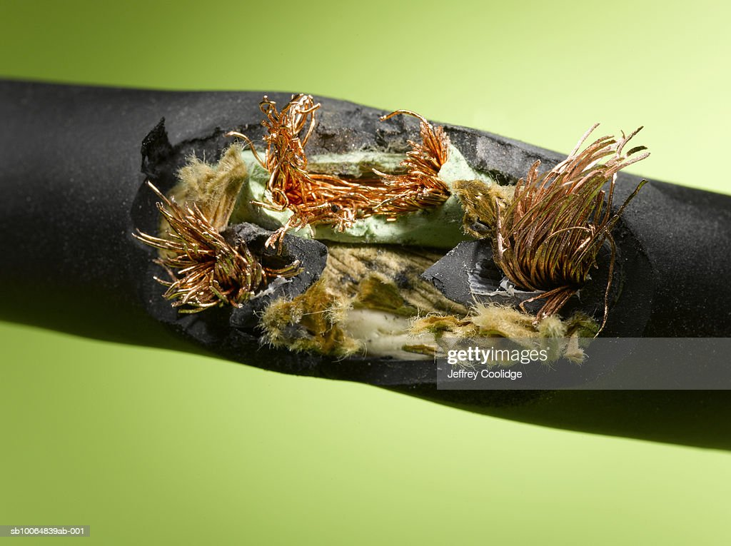 Frayed electrical cable, close-up : Stock Photo