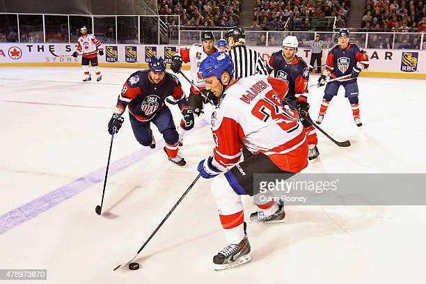 Frazer McLaren of Canada controls the puck during the 2015 Ice Hockey Classic match between the United States of America and Canada at Rod Laver...