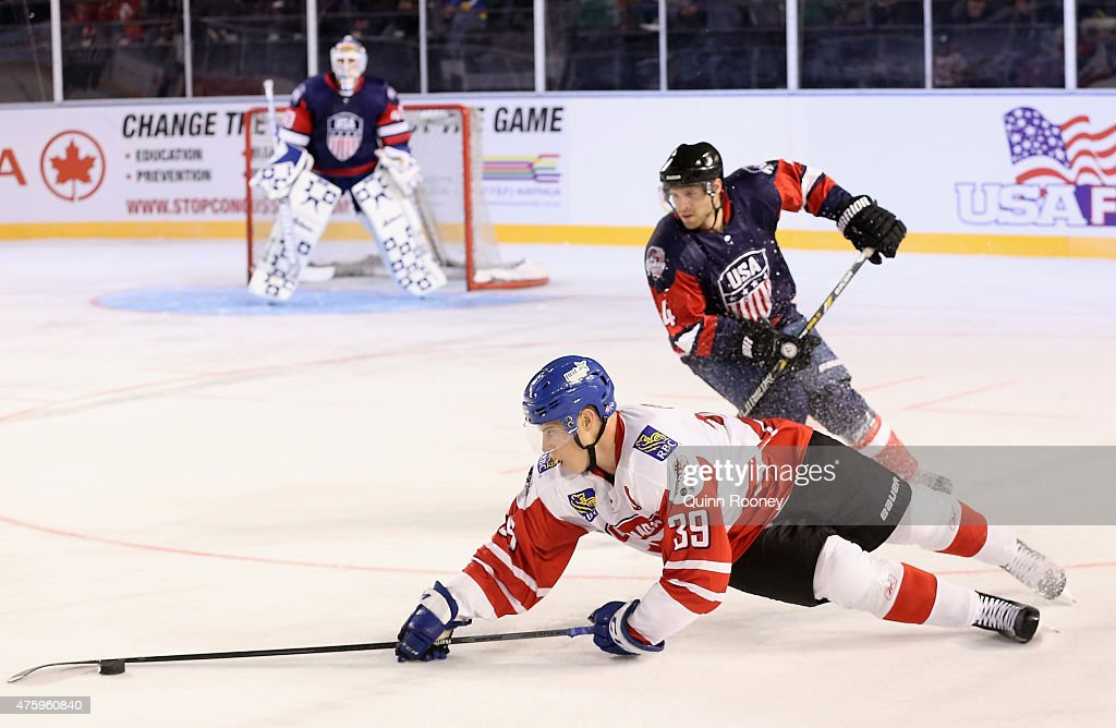<a gi-track='captionPersonalityLinkClicked' href=/galleries/search?phrase=Frazer+McLaren&family=editorial&specificpeople=4601054 ng-click='$event.stopPropagation()'>Frazer McLaren</a> of Canada dives for the puck during the 2015 Ice Hockey Classic match between the United States of America and Canada at Rod Laver Arena on June 5, 2015 in Melbourne, Australia.