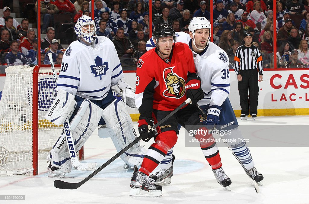 Frazer McLaren #38 of the Toronto Maple Leafs defends against Jim O'Brien #18 of the Ottawa Senators as <a gi-track='captionPersonalityLinkClicked' href=/galleries/search?phrase=Ben+Scrivens&family=editorial&specificpeople=7185205 ng-click='$event.stopPropagation()'>Ben Scrivens</a> #30 of the Toronto Maple Leafs looks on, during an NHL game at Scotiabank Place on February 23, 2013 in Ottawa, Ontario, Canada.
