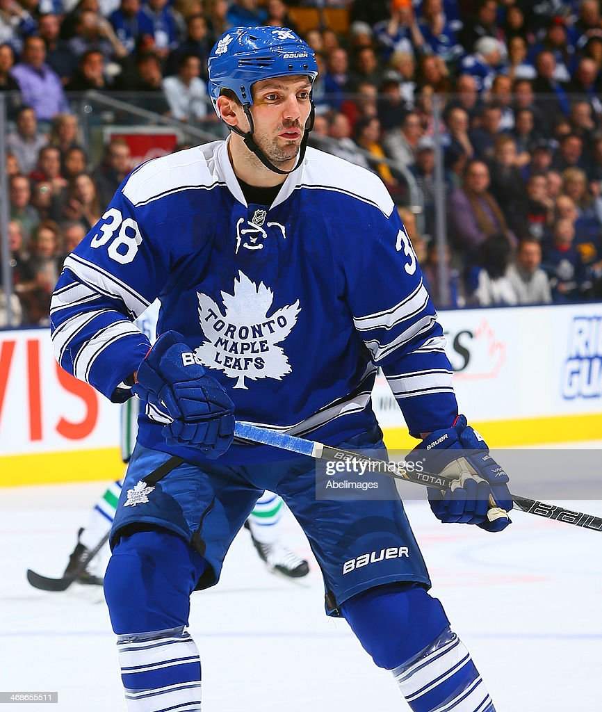 <a gi-track='captionPersonalityLinkClicked' href=/galleries/search?phrase=Frazer+McLaren&family=editorial&specificpeople=4601054 ng-click='$event.stopPropagation()'>Frazer McLaren</a> #38 of the Toronto Maple Leafs skates up the ice during NHL action against the Vancouver Canucks at the Air Canada Centre February 8, 2014 in Toronto, Ontario, Canada.
