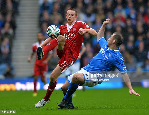 Frazer Wright of St Johnstone and Adam Rooney of Aberdeen challenge during the William Hill Scottish Cup Semi Final between St Johnstone and Aberdeen...