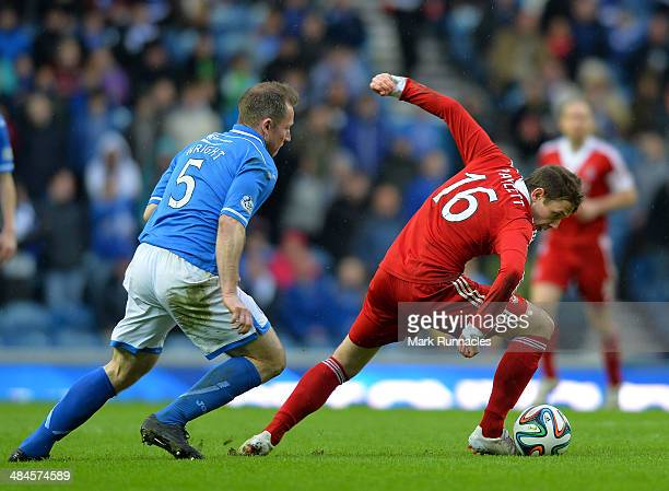 Frazer Wright of St Johnstone and Peter Pawlett of Aberdeen challenge during the William Hill Scottish Cup Semi Final between St Johnstone and...