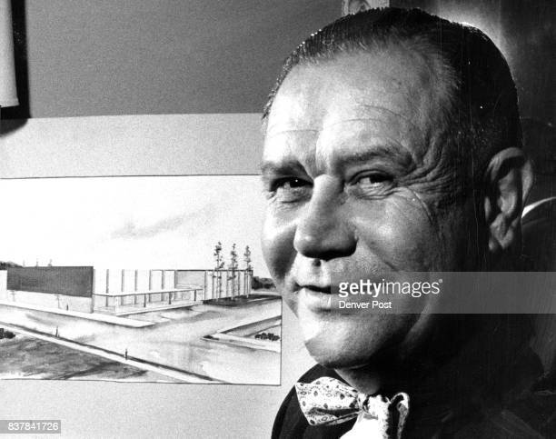 Fred A Ward in his suite at Writers' Manor poses in front of an architect's sketch of the proposed community market he said a group of Denver...