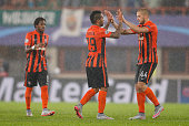 Fred Alex Teixeira and Yaroslav Rakitskiy of Donetsk celebrate after winning the UEFA Champions League Qualifying Round Play Off First Leg match...