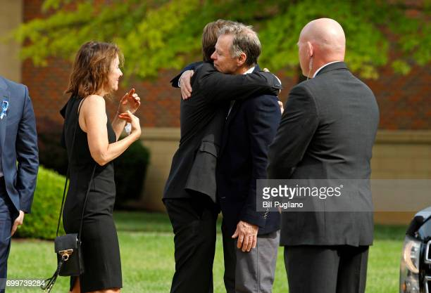 Fred and Cindy Warmbier greet guest during the funeral for their son Otto Warmbier at Wyoming High School June 22 2017 in Wyoming Ohio Otto Warmbier...