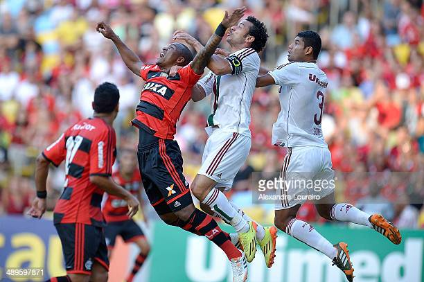 Fred and Gum of Fluminense battles for the ball with Samir of Flamengo during the match between Fluminense and FlamengoÊ as part of Brasileirao...
