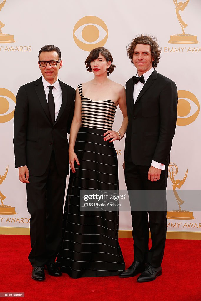 <a gi-track='captionPersonalityLinkClicked' href=/galleries/search?phrase=Fred+Armisen&family=editorial&specificpeople=221426 ng-click='$event.stopPropagation()'>Fred Armisen</a>, <a gi-track='captionPersonalityLinkClicked' href=/galleries/search?phrase=Carrie+Brownstein&family=editorial&specificpeople=870017 ng-click='$event.stopPropagation()'>Carrie Brownstein</a> and Jonathan Krisel on the Red Carpet for the 65th Primetime Emmy Awards, which will be broadcast live across the country 8:00-11:00 PM ET/ 5:00-8:00 PM PT from NOKIA Theater L.A. LIVE in Los Angeles, Calif., on Sunday, Sept. 22 on the CBS Television Network.
