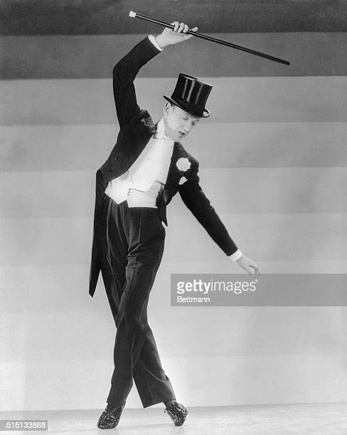 Fred Astaire musical comedy and film star rehearses a new step for Top Hat the RKO Radio musical in which he co stars with Ginger Rogers The music...