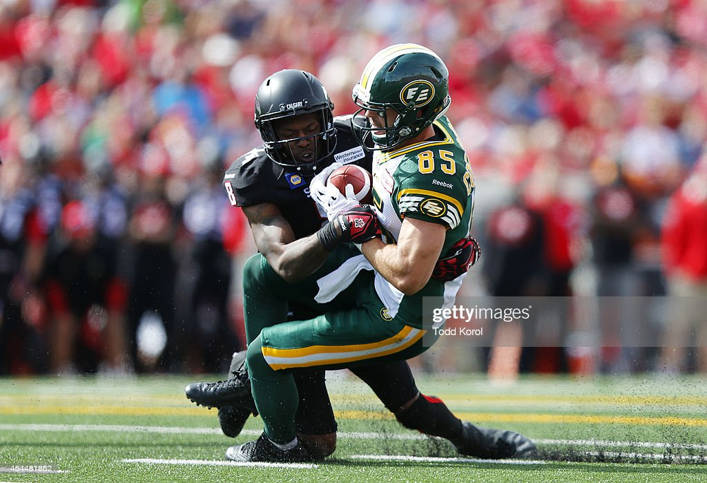 Fred Bennett #8 of the Calgary Stampeders tackles Nathan Coehoorn #8 of the Edmonton Eskimos in the first half of their CFL football game September 1, 2014 at McMahon Stadium in Calgary, Alberta, Canada.