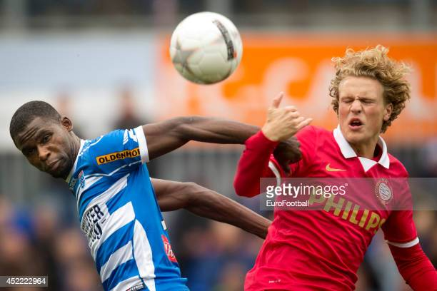 Fred Benson of PEC Zwolle tackles a PSV Eindhoven player during the Eredivisie Dutch League match between PEC Zwolle and PSV Eindhoven at the...