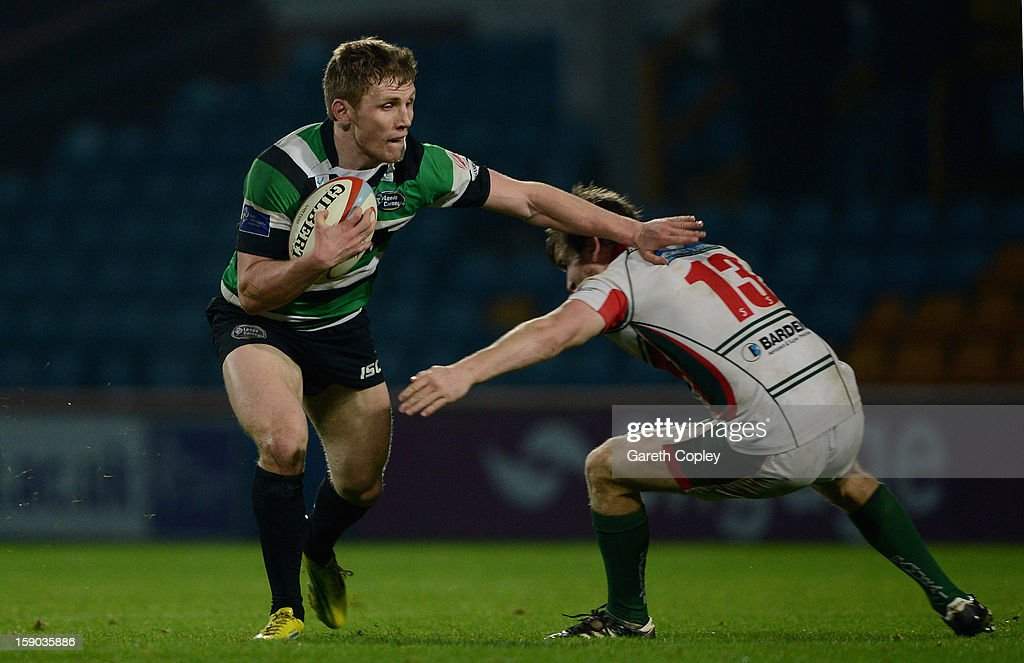 Fred Burdon of Leeds is tackled by Toby Howley-Berridge of Plymouth during the RFU Championship match between Leeds Carnegie and Plymouth Albion at Headingley Carnegie Stadium on January 6, 2013 in Leeds, England.