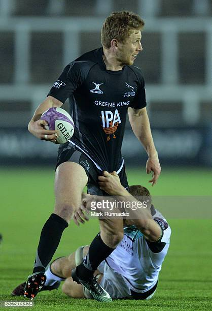 Fred Burdon of Newcastle Falcons is tackled by Sam Underhill of Ospreys Rugby during the European Rugby Challenge Cup pool 2 match between Newcastle...