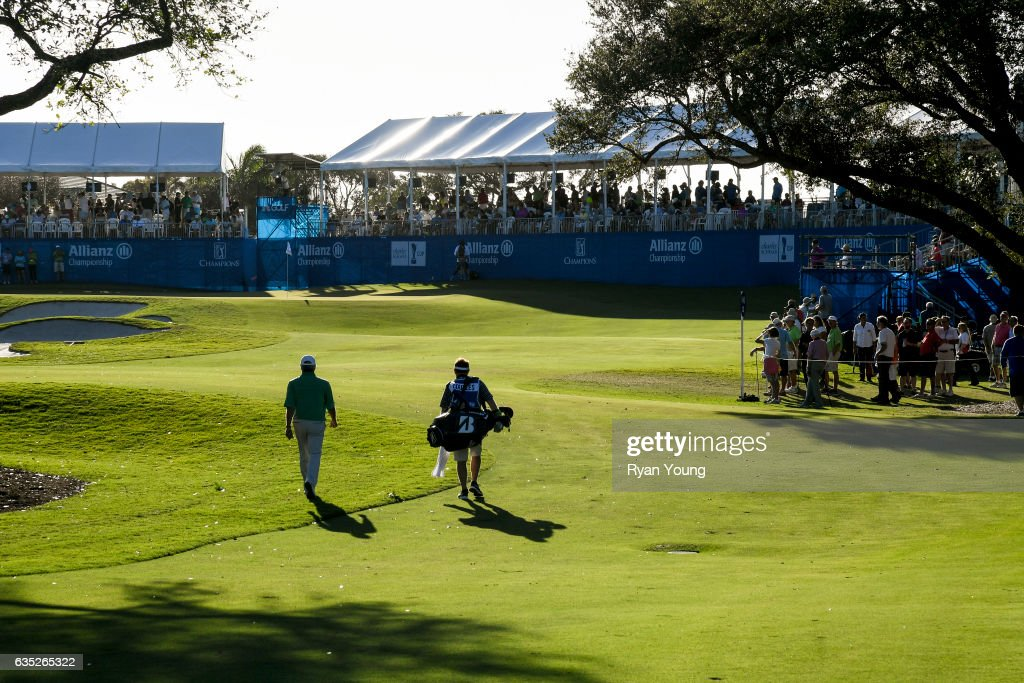Fred Couples and his caddy walk up the 18th fairway during the second round of the PGA TOUR Champions Allianz Championship at The Old Course at Broken Sound on February 11, 2017 in Boca Raton, Florida.