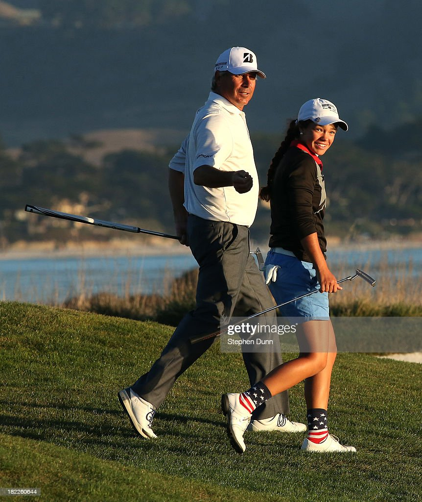 <a gi-track='captionPersonalityLinkClicked' href=/galleries/search?phrase=Fred+Couples&family=editorial&specificpeople=203076 ng-click='$event.stopPropagation()'>Fred Couples</a> and his junior First Tee playing partnerAshley Sloup walk together to the 18th tee durng the second round of the Nature Valley First Tee Open at Pebble Beach at Pebble Beach Golf Links on September 28, 2013 in Pebble Beach, California.