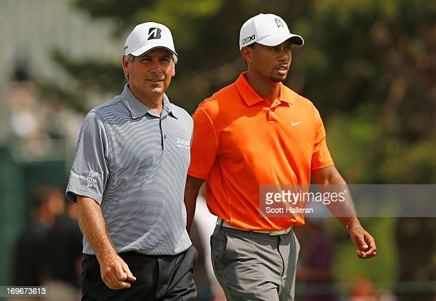 Fred Couples and Tiger Woods walk off the 11th tee during the first round of the Memorial Tournament presented by Nationwide Insurance at Muirfield...