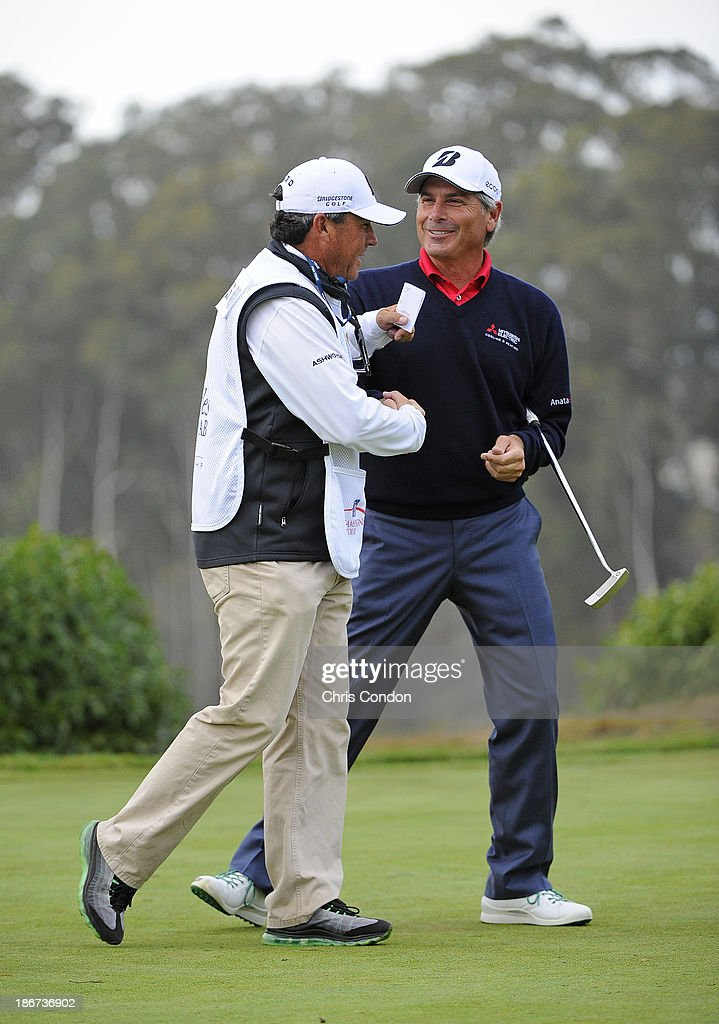 <a gi-track='captionPersonalityLinkClicked' href=/galleries/search?phrase=Fred+Couples&family=editorial&specificpeople=203076 ng-click='$event.stopPropagation()'>Fred Couples</a> celebrates with his caddie Cayce Kerr on the 18th green after winning the Charles Schwab Cup Championship at TPC Harding Park on November 3, 2013 in San Francisco, California.