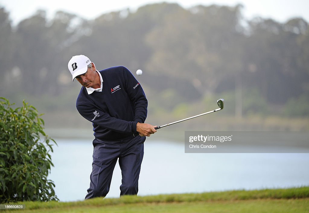 <a gi-track='captionPersonalityLinkClicked' href=/galleries/search?phrase=Fred+Couples&family=editorial&specificpeople=203076 ng-click='$event.stopPropagation()'>Fred Couples</a> chips to the 18th green during the third round of the Charles Schwab Cup Championship at TPC Harding Park on November 2, 2013 in San Francisco, California.