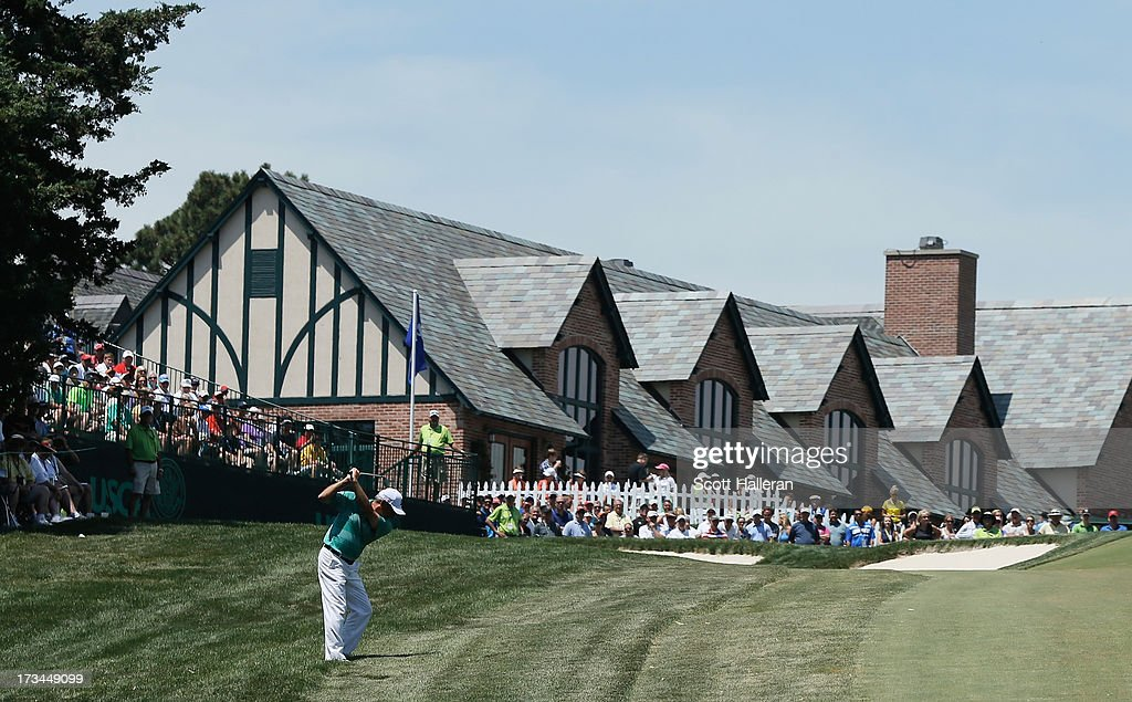 <a gi-track='captionPersonalityLinkClicked' href=/galleries/search?phrase=Fred+Couples&family=editorial&specificpeople=203076 ng-click='$event.stopPropagation()'>Fred Couples</a> hits a shot to the ninth green during the final round of the 2013 U.S. Senior Open Championship at Omaha Country Club on July 14, 2013 in Omaha, Nebraska.