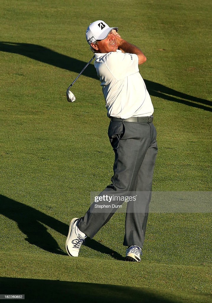 <a gi-track='captionPersonalityLinkClicked' href=/galleries/search?phrase=Fred+Couples&family=editorial&specificpeople=203076 ng-click='$event.stopPropagation()'>Fred Couples</a> hits his second shot on the 16th hole durng the second round of the Nature Valley First Tee Open at Pebble Beach at Pebble Beach Golf Links on September 28, 2013 in Pebble Beach, California.