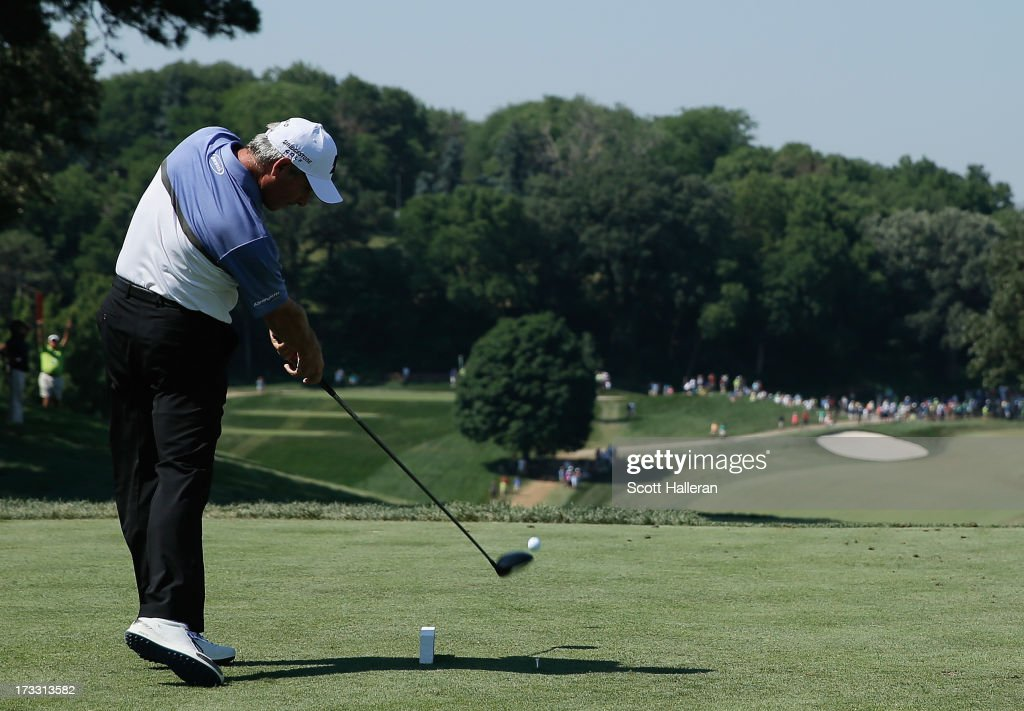 <a gi-track='captionPersonalityLinkClicked' href=/galleries/search?phrase=Fred+Couples&family=editorial&specificpeople=203076 ng-click='$event.stopPropagation()'>Fred Couples</a> hits his tee shot on the tenth hole during the first round of the 2013 U.S. Senior Open Championship at Omaha Coutry Club on July 11, 2013 in Omaha, Nebraska.