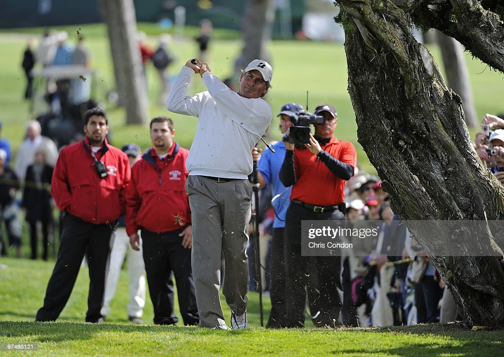 Fred Couples hits left-handed from under a tree on #10 during the second round of the Toshiba Classic at Newport Beach Country Club on March 6, 2010 in Newport Beach, California.