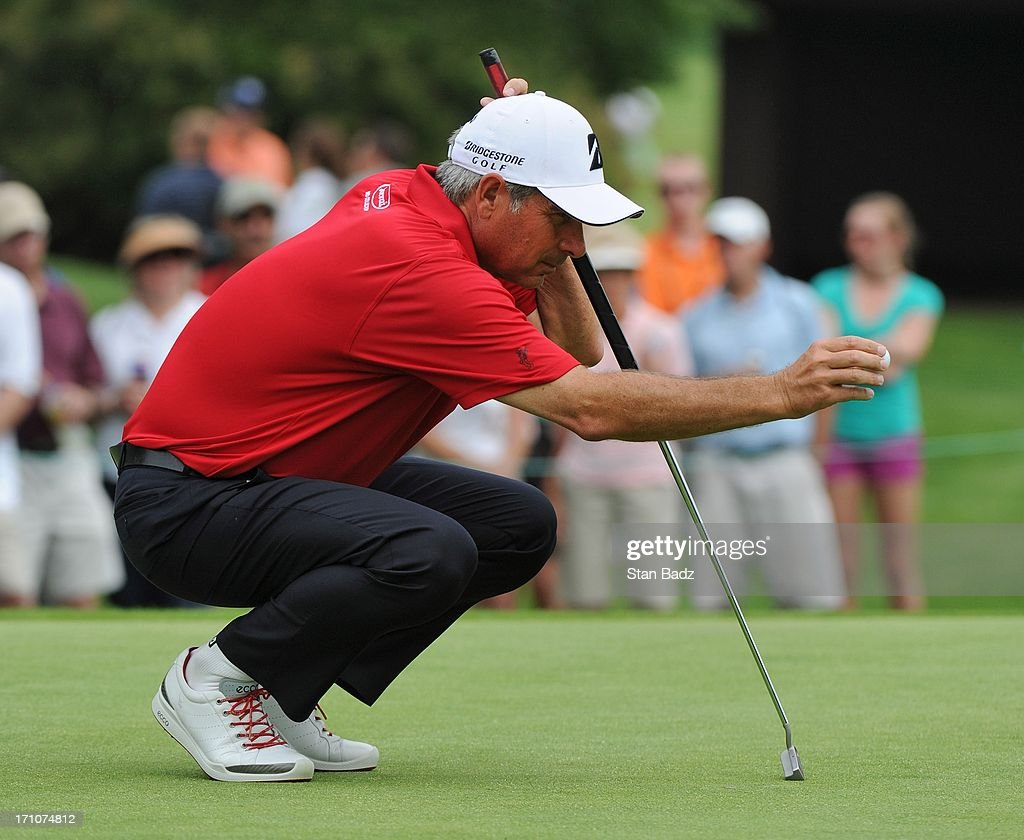 Fred Couples lines his ball for a putt on the second hole during the first round of the Encompass Championship at North Shore Country Club on June 21, 2013 in Glenview, Illinois.