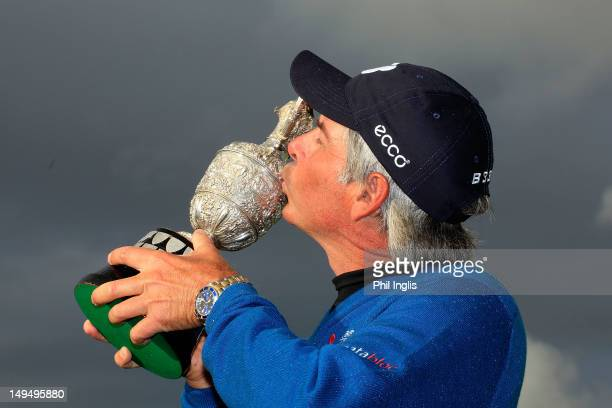 Fred Couples of the United States kisses the trophy after the final round of the Senior Open Championship played over the Ailsa Course Turnberry on...