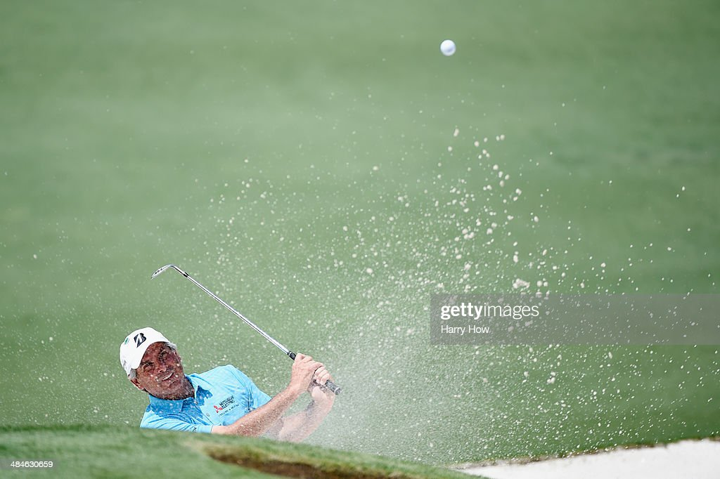 Fred Couples of the United States plays a bunker shot on the second hole during the final round of the 2014 Masters Tournament at Augusta National Golf Club on April 13, 2014 in Augusta, Georgia.