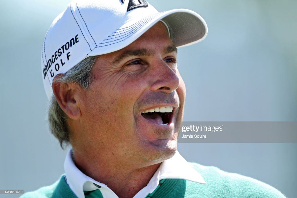 Fred Couples of the United States reacts while standing on the 18th green after finishing the second round of the 2012 Masters Tournament at Augusta National Golf Club on April 6, 2012 in Augusta, Georgia.