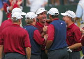 Fred Couples of the US team celebrates with teammates and captain Jack Nicklaus during the singles matches in the final round of The Presidents Cup...