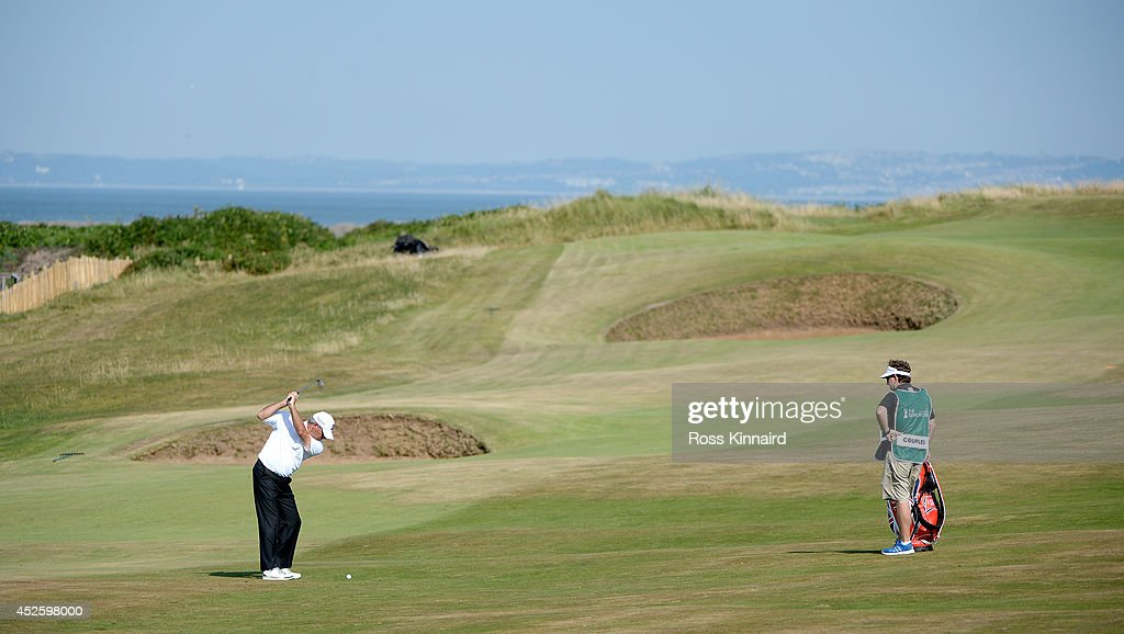 Fred Couples of the USA plays his second shot on the par four 2nd hole during the first round of the Senior Open Championship at Royal Porthcawl Golf Club on July 24, 2014 in Bridgend, Wales.
