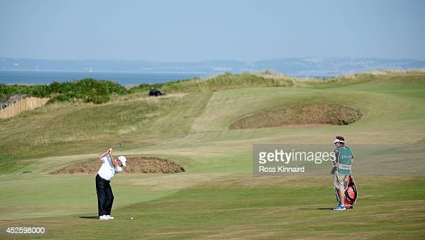 Fred Couples of the USA plays his second shot on the par four 2nd hole during the first round of the Senior Open Championship at Royal Porthcawl Golf...