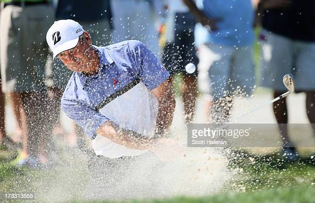 Fred Couples plays a bunker shot on the 11th hole during the first round of the 2013 US Senior Open Championship at Omaha Coutry Club on July 11 2013...